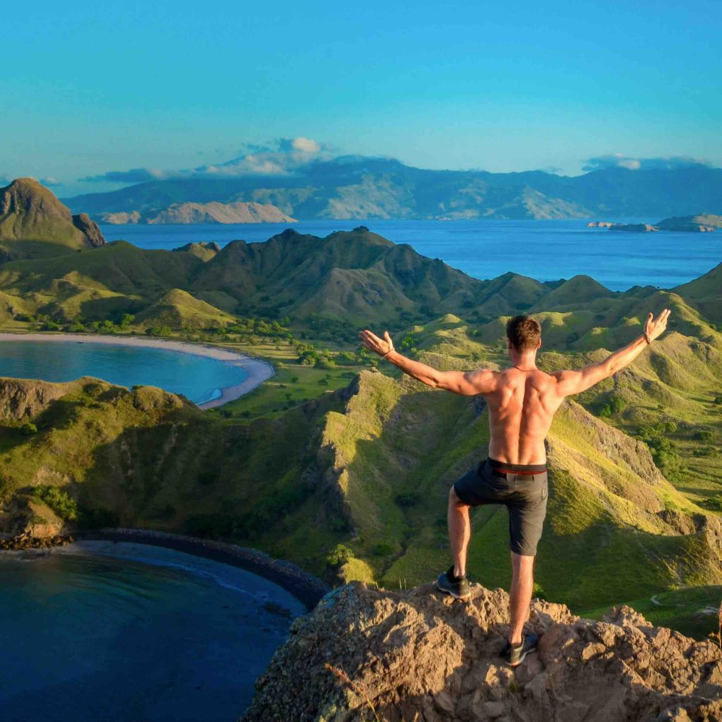 Francois without a t-shirt overlooking the islands of Indonesia