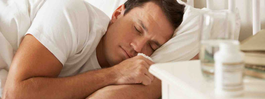 Man in bed sleeping peacefully to rest well