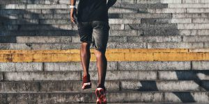 Man running up the stairs with sport clothes