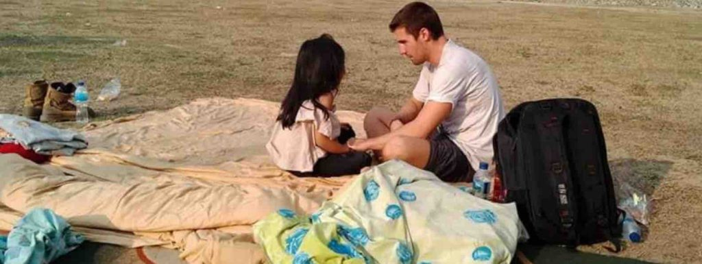 François de Neuville saved the life of a 5 year old girl after a double natural disaster in Palu Indonesia, sitting on a blanket after running away from the tsunami