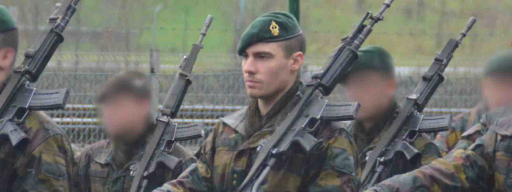 Francois in army walking with gun and other soldiers