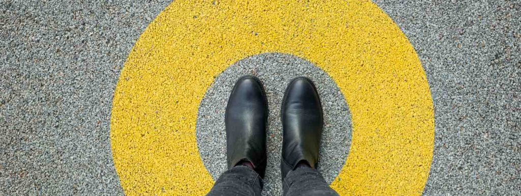 man with shoes in the middle of a circle of comfort with a yellow line surrounding it