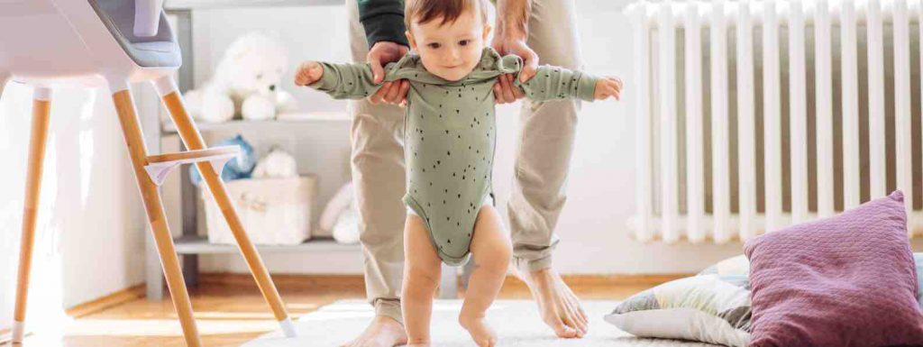 Baby learning to walk showing to never give up
